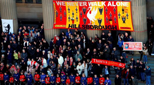 Family members of the Hillsborough victims attend a commemorative event at St George's Hall in Liverpool last week, to mark the outcome of the Hillsborough inquest which ruled that 96 Liverpool fans who died as a result of the Hillsborough disaster were unlawfully killed. Photo: Peter Byrne/PA