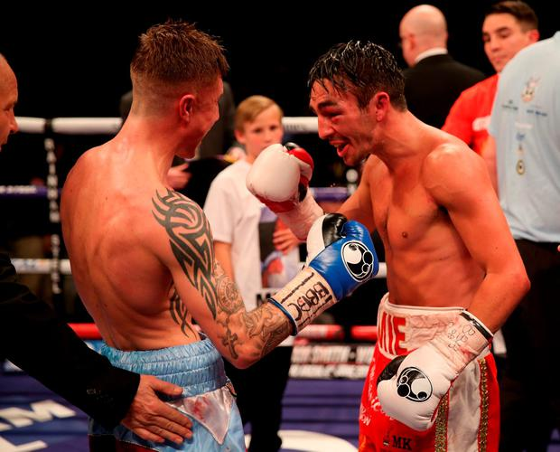 Jamie Conlan (red and white shorts) celebrates victory over Anthony Nelson (claret and blue shorts) after the Commonwealth Super Flyweight Championship