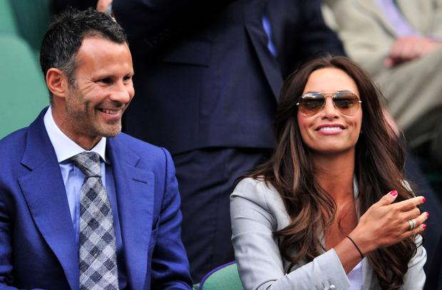 Wales and Manchester United footballer Ryan Giggs (L) and his wife Stacey Cooke in the Royal Box before play on day six of the 2012 Wimbledon Championships tennis tournament at the All England Tennis Club in Wimbledon, southwest London, on June 30, 2012. Photo: GLYN KIRK/AFP/GettyImages)