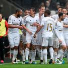Swansea's Jack Cork celebrates scoring their second goal with team mates