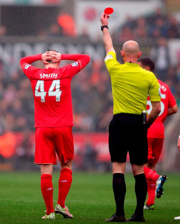 Liverpool's Brad Smith is shown a red card by referee Roger East