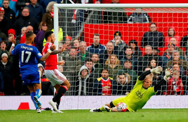 Leicester's Kasper Schmeichel in action with Manchester United's Memphis Depay