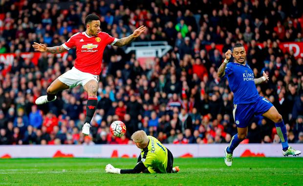 Leicester City's Kasper Schmeichel in action with Manchester United's Memphis Depay