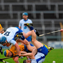 Jamie Barron, right, and Patrick Curran, Waterford, in action against Oisín OBrien, Clare