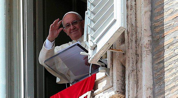 Pope Francis waves as he leads the Angelus prayer in Saint Peter's square at the Vatican May 1, 2016
