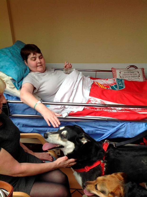 Denise in hospital with her pet dog