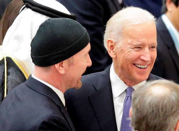 U.S. Vice President Joe Biden (R) talks with U2 guitarist David Evans, also known by his stage name The Edge, in Paul VI hall at the Vatican April 29, 2016