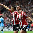 SOUTHAMPTON, ENGLAND - MAY 01: Shane Long (R) of Southampton celebrates scoring the opening goal with Dusan Tadic during the Barclays Premier League match between Southampton and Manchester City at St Mary's Stadium on May 1, 2016 in Southampton, England. (Photo by Mike Hewitt/Getty Images)