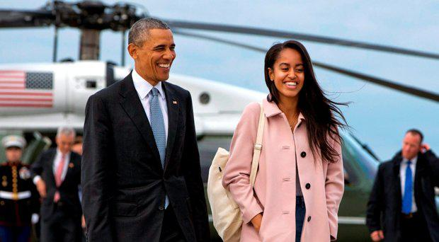 President Barack Obama jokes with his daughter Malia Obama as they walk to board Air Force One from the Marine One helicopter, as they leave Chicago en route to Los Angeles