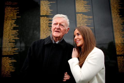 Terence O'Neill with his grandaughter Aisling Lawlor at the memorial wall in Glasnevin yesterday. Photo: Gerry Mooney