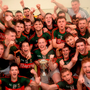 Mayo players celebrate with the cup in the dressing room after winning the EirGrid All-Ireland Under 21 football final Photo: Sportsfile