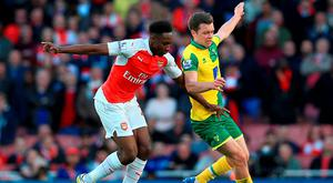 Arsenal's Danny Welbeck and Norwich City's Jonny Howson battle for the ball during the Barclays Premier League match at the Emirates Stadium Photo: John Walton/PA