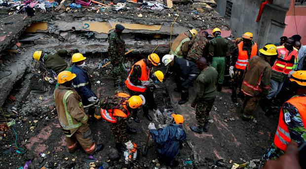 Rescue workers searching for residents feared trapped in the rubble of a six-storey building that collapsed after days of heavy rain in Nairobi. Photo: Reuters
