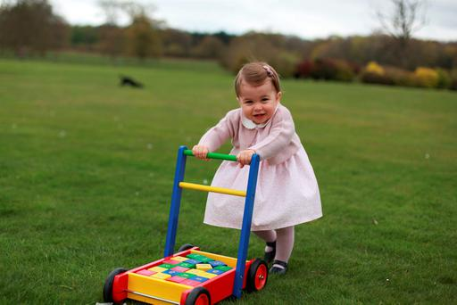 Princess Charlotte poses for a photograph taken by her mother Kate Middleton, who is to appearon the cover of 'Vogue', inset, for its June centenary issue. Photo: Reuters