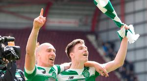 Celtic's Kieran Tierney (right) and Scott Brown celebrate at the end of the match at Tynecastle Stadium. Photo: Jeff Holmes/PA