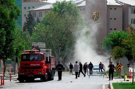 Security officers and firefighters work moments after an explosion outside the Police headquarters in Gaziantep. Photo: AP