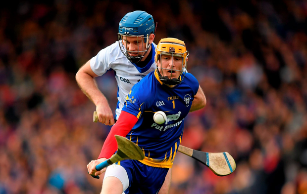 Clare goalkeeper Patrick Kelly under pressure from Waterford's Michael Walsh during their Allianz NHL final Photo: Sportsfile