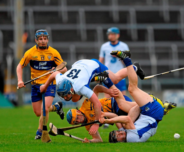 Jamie Barron (right) and Patrick Curran of Waterford in action against Clare's Oisín O'Brien during their Allianz NHL final Photo: Sportsfile