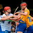 Darach Honan, Clare, and Jamie Barron and Tadhg de Búrca, Waterford, in a tussle during the game Photo: Sportsfile