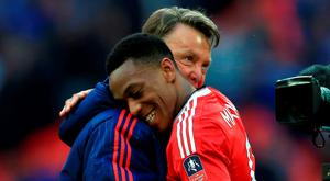 Louis van Gaal embraces Anthony Martial (right) after the final whistle Photo: PA