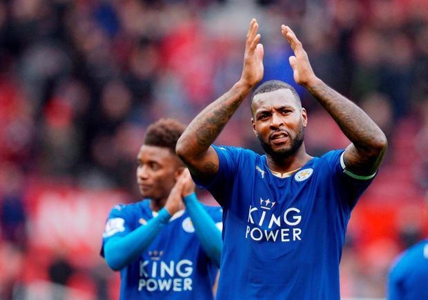 Leicester City's English defender Wes Morgan (r) applauds fans after the game Photo: Getty