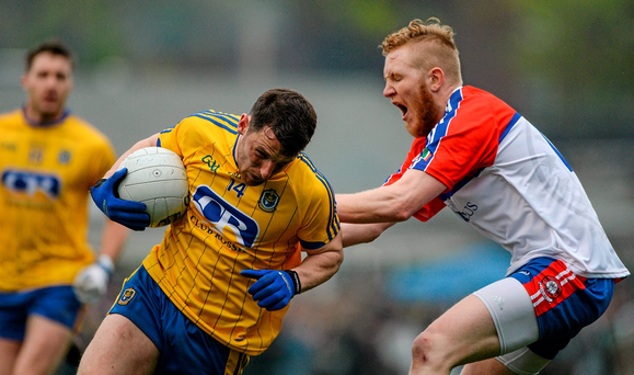 Diarmuid Murtagh, Roscommon, in action against Paddy Boyle, New York Photo: Sportsfile