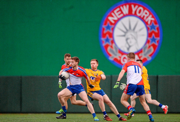 Brian Gallagher, New York, in action against Niall Daly, Roscommon Photo: Sportsfile