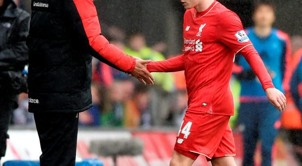 Liverpool manager Juergen Klopp with Brad Smith after he was sent off against Swansea