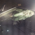 The brick struck the windscreen in front of the driver, smashing it. Photo: Twitter/ @PoliceServiceNI