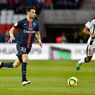 PARIS, FRANCE - APRIL 29: Javier Pastore of Paris Saint-Germain runs with the ball during the Ligue 1 match between Paris Saint-Germain and Stade Rennais at Parc des Princes on April 29, 2016 in Paris, France. (Photo by Aurelien Meunier/Getty Images)