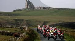 Bikers arrive in Mullaghmore against the backdrop of the iconic Classiebawn Castle and Ben Bulben, in Co Sligo, as part of the Revup4DSI event for Down Syndrome Ireland. Photo: Brian Farrell