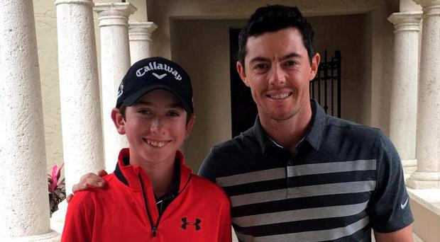Learning from a legend: Tom McKibbin (13) is following in Rory McIlroy's footsteps