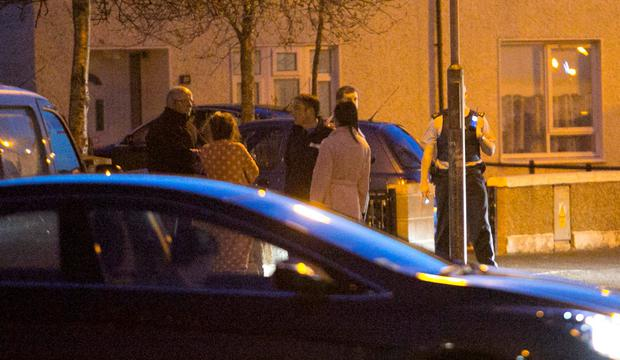 Local people gather as gardaí secure the shooting scene at Shancastle Drive in Clondalkin last night. Photo: Collins