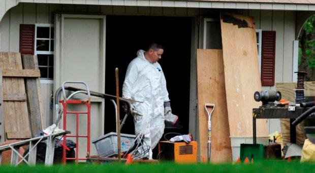 A law enforcement agent searches a shed behind the home of reputed Connecticut mobster Robert Gentile. (File Picture) Credit: AP