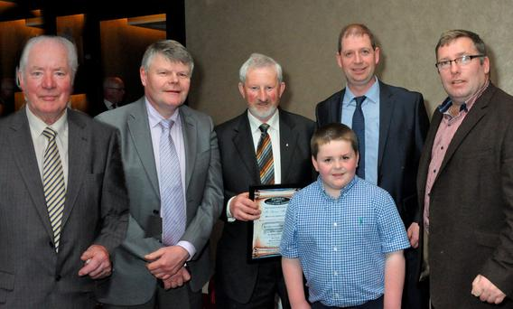 Michael Flanagan, CEO, National Hall of Fame Awards; Denis McCarthy, Simmental Society; Seamus Aherne, Co Limerick, winner of the Irish Simmental Cattle Society Hall of Fame award with his son, Mark; Peader Glennon and Tom Moloney, both of the Irish Simmental Cattle Society