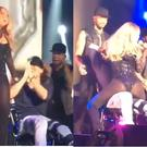 Mariah Carey treats a fan to a very awkward lap dance on stage