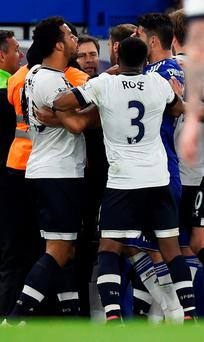 Chelsea's Diego Costa clashes with Tottenham's Mousa Dembele and Danny Rose after the match