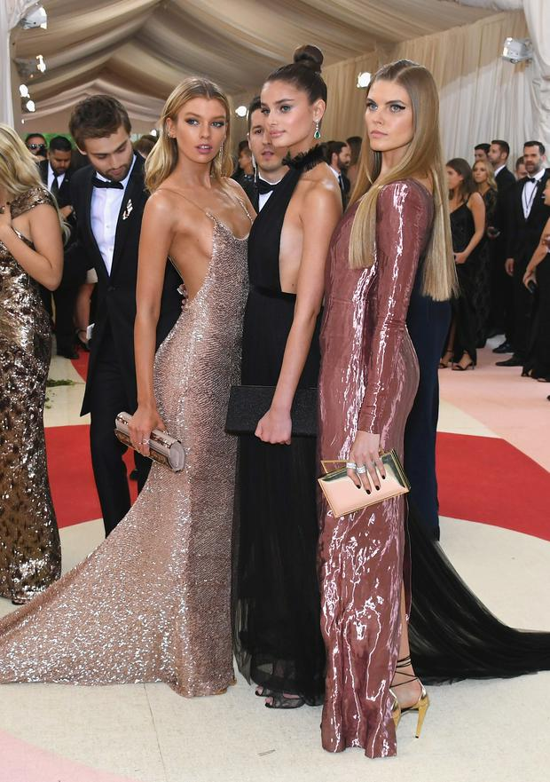 (L-R) Models Stella Maxwell, Taylor Hill, and Maryna Linchuk attend the