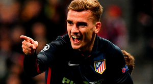 Atletico Madrid's French forward Antoine Griezmann celebrates scoring during the UEFA Champions League semi-final, second-leg football match between FC Bayern Munich and Atletico Madrid in Munich, southern Germany, on May 3, 2016. / AFP PHOTO / LUKAS BARTHLUKAS BARTH/AFP/Getty Images