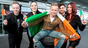 Nicky Byrne with backing band Ian White, Jennifer Healy, Jason Boland and Janet Grogan at Dublin Airport. Photo: Kyran O'Brien
