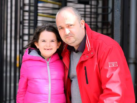 Emma Olteanu with her father Marius leaving the Four Courts yesterday. Photo: Collins Courts