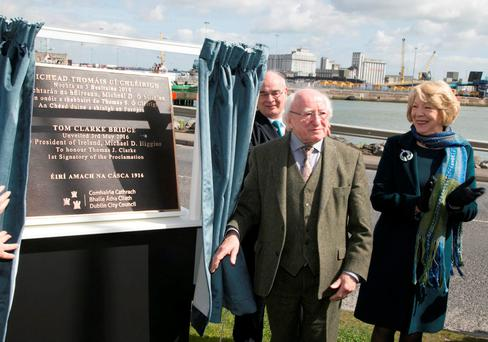 President Michael D Higgins unveils a plaque renaming the East Link Bridge the 'Tom Clarke Bridge'. Photo: Colm Mahady / Fennells