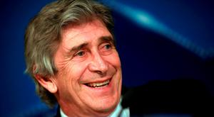 Confident: Manuel Pellegrini in relaxed mood yesterday (PA)