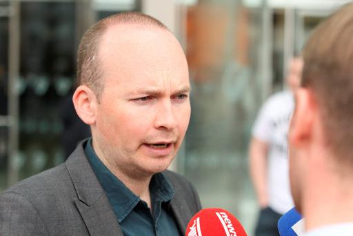 Anti-Austerity Alliance TD Paul Murphy and 18 others have contested a State application for separate trials on charges of false imprisonment of Deputy Joan Burton and other offences, following a water protest in Jobstown two years ago. Photo: Collins Courts