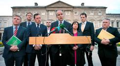 Pictured is Fianna Fail Leader Micheal Martin TD, centre, with, from left, Michael McGrath TD, Jim O'Callaghan TD, Barry Cowen TD, Dara Calleary TD, Fiona O'Loughlan TD, Charlie McConalogue TD and Eugene Murphy TD talking to the media at the Dail this evening. Photo: RollingNews.ie