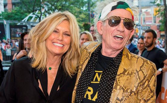 Rolling Stones guitarist Keith Richards with his wife Hansen. REUTERS/Mark Blinch