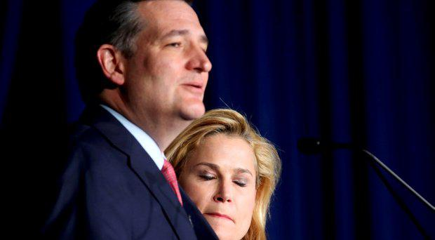 Heidi Cruz, wife of Republican U.S. presidential candidate Senator Ted Cruz, bites her lip and closes her eyes as she listens to her husband drop out of the race for the 2016 Republican presidential nomination during his Indiana primary night rally in Indianapolis, Indiana, U.S., May 3, 2016
