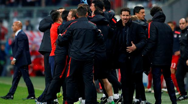 Atletico Madrid coach Diego Simeone celebrates after the game