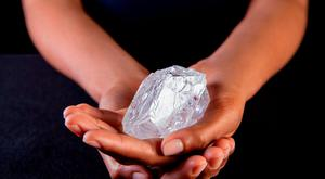 A Sotherby's employee holds Lesedi La Rona Diamond on May. (Donald Bowers/Getty Images for Sotheby's, via AP)