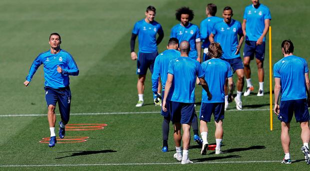 Real Madrid's Cristiano Ronaldo, left, works out with teammates during a training session